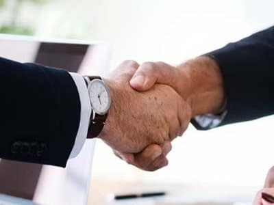 medical aid broker services two people shaking hands