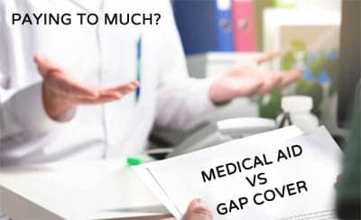 gap cover costs vs medical aid doctor with patient hands paperwork