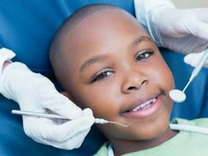 limited day to day cover south africa smiling boy at dentist